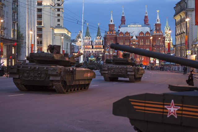 The New Russian T-14 Armata tanks make their way to Red Square with the Historical Museum in the background, during a rehearsal for the Victory Day military parade which will take place at Moscow's Red Square on May 9 to celebrate 70 years after the victory in WWII, in Moscow, Russia, Monday, May 4, 2015. (Photo by Alexander Zemlianichenko/AP Photo)
