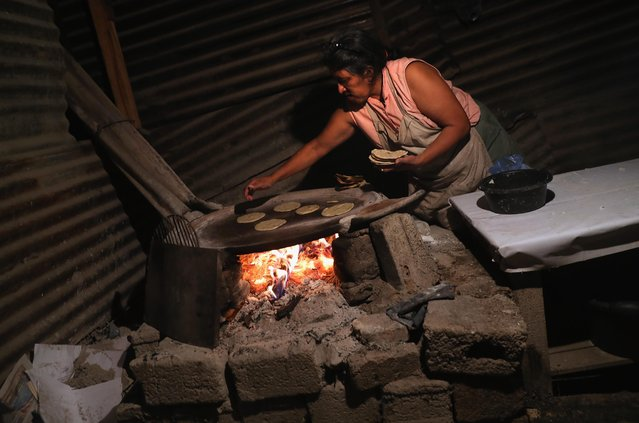 A woman cooks tortillas in her home on February 9, 2017 in Peronia, Guatemala. (Photo by John Moore/Getty Images)