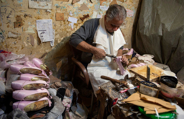 Mahmoud Saleh, 67, works at his workshop in al-Omraneyah district of Giza, Egypt, 19 January 2019 (Issued 02 February 2019). Mahmoud Saleh, 67, is the owner of the only workshop that produces handmade ballet shoes in Egypt. He started working 51 years ago when his father, a craftsman for soccer, wrestling, and boxing shoes, was approached by a Russian expert residing in Egypt in 1968 to offer him and his son to work at his factory after seeing their products. In 1980 Saleh left the factory and started his own business which became famous, and in 1991 the Cairo Opera House contracted him to be the manufacturer of its Ballet Company for 12 thousand Egyptian pounds (then four thousand US dollars), with this money he bought a bigger workshop at al-Omraneyah district of Giza and never stopped producing ever since. Nowadays, Saleh's work is exported to many countries, including Russia, Germany, Italy, and UAE, as well as suppling handmade ballet shoes to all ballet centers in Egypt. (Photo by Mohamed Hossam/EPA/EFE)