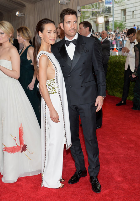 "Maggie Q, left, and Dylan McDermott arrive at The Metropolitan Museum of Art's Costume Institute benefit gala celebrating ""China: Through the Looking Glass"" on Monday, May 4, 2015, in New York. (Photo by Evan Agostini/Invision/AP Photo)"