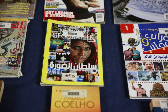 A National Geographic Magazine that has been defaced by inmates is shown in Joint Task Force Guantanamo's library at the U.S. Naval Base in Guantanamo Bay, Cuba March 22, 2016. (Photo by Lucas Jackson/Reuters)