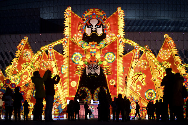 People walk past a lighted display celebrating the Lantern Festival at a park in Beijing Friday, February 10, 2017. Saturday is the Lantern Festival in China, the final day of the annual celebration of the Chinese Lunar New Year. (Photo by Mark Schiefelbein/AP Photo)