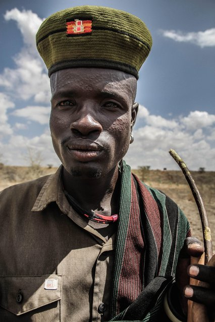 Scarrified dots around the eye area are a common beauty feature in the Karamojong culture. They are usually pricked by thorns and rubbed with mud to add surface, Karamoja, Uganda, February, 2017. (Photo by Sumy Sadurni/Barcroft Images)