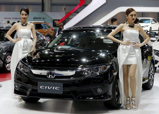 Models pose beside a Honda Civic car during a media presentation at the 37th Bangkok International Motor Show in Bangkok, Thailand March 22, 2016. (Photo by Chaiwat Subprasom/Reuters)