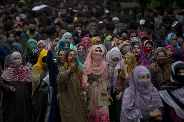 Kashmiri village women shout pro freedom slogans as they participate in funeral procession of top rebel commander Naseer Pandith, in Pulwama, south of Srinagar, Indian controlled Kashmir, Thursday, May 16, 2019. Three rebels, an army soldier and a civilian were killed early Thursday during a gunbattle in disputed Kashmir that triggered anti-India protests and clashes, officials and residents said. (Photo by Dar Yasin/AP Photo)