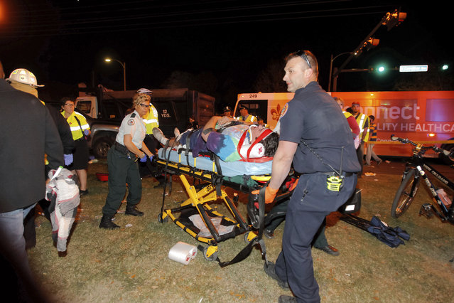 New Orleans emergency personnel attend to an injured parade watcher after a pickup truck plowed into a crowd injuring multiple people watching the Krewe of Endymion parade in the Mid-City section of New Orleans, Saturday, February 25, 2017. Police Chief Michael Harrison says one person in custody and that he is being investigated for driving while intoxicated. (Photo by Scott Threlkeld/The Advocate via AP Photo)