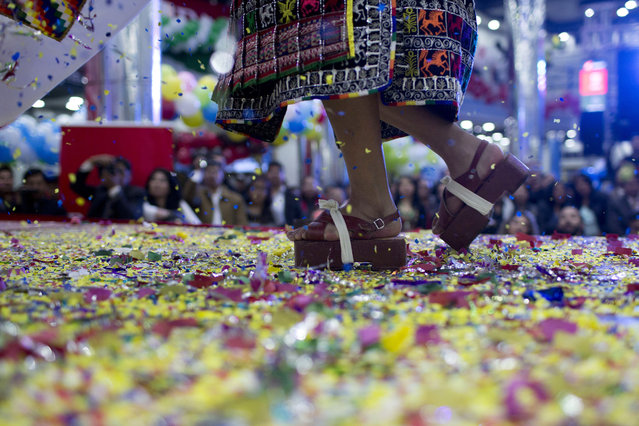 "A contestant performs in wooden Pujllay dance shoes known as ""ojotas"", in a contest to elect the Queen of Great Power, in La Paz, Bolivia, Friday, May 24, 2019. (Photo by Juan Karita/AP Photo)"