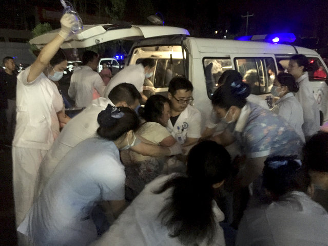 In this photo released by Xinhua News Agency, medical staff tend to a wounded at a local hospital in the aftermath of an earthquake in Changning County of Yibin City, southwest China's Sichuan Province, early Tuesday, June 18, 2019. The strong earthquake that hit Sichuan province in southern China late Monday night killed and injured some, officials and news reports said. (Photo by Wan Min/Xinhua via AP Photo)
