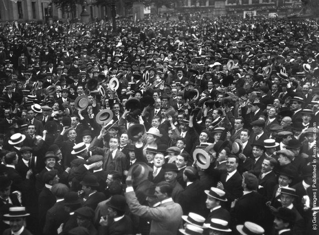 1914: Crowds, many waving boaters, cheer Britain's declaration of war on Germany in Trafalgar Square, London