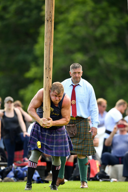The world's best caber tossers compete at Inveraray Highland Games on July 16, 2019 in Inverarary, Scotland. (Photo by Jeff J. Mitchell/Getty Images)