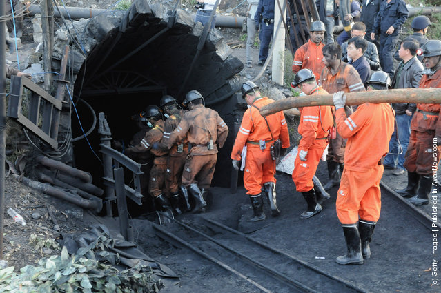 Rescuers prepare to enter the Sizhuang Coal Mine to rescue trapped miners
