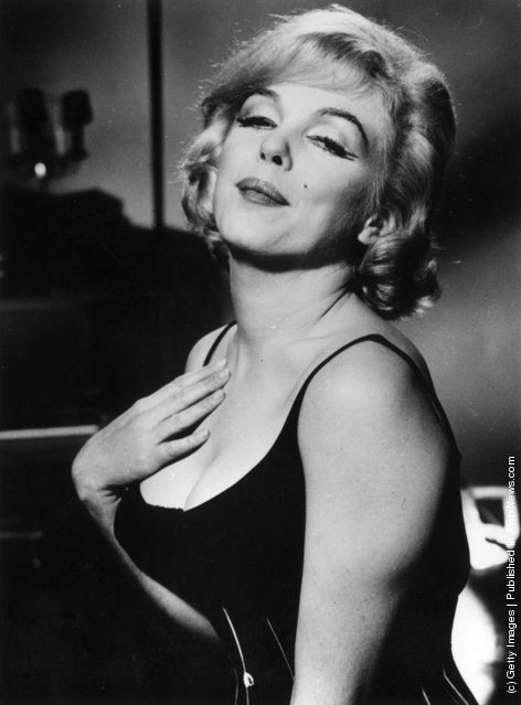 1960:  American film actress Marilyn Monroe (1926 - 1962) during the making of the film 'Lets Make Love', directed by George Cukor