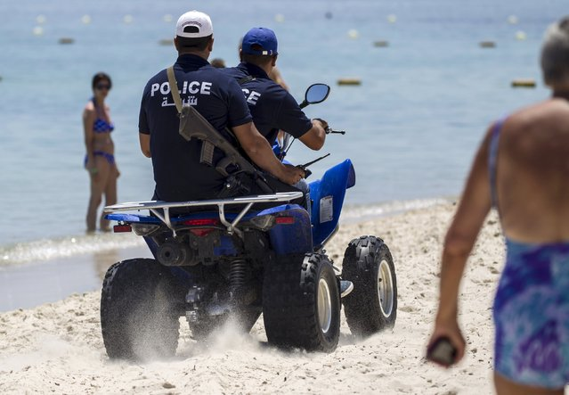 Police officers patrol the beach near the Imperial Marhabada resort, which was attacked by a gunman in Sousse, Tunisia, June 28, 2015. Hundreds of armed police patrolled the streets of Tunisia's beach resorts on Sunday and the government said it will deploy hundreds more inside hotels after the Islamist militant attack in Sousse that killed 39 foreigners, mostly Britons. (Photo by Zohra Bensemra/Reuters)