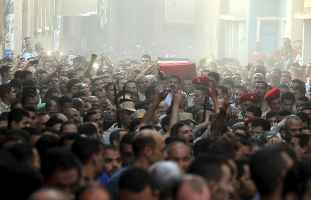 Relatives of 21-year-old Mohamed Adel, one of the army officers who died in yesterday's Sinai attacks, carry his coffin during the funeral in Al-Kaliobeya, near Cairo, Egypt, July 2, 2015. Egypt launched air strikes on Islamist militant targets in the Sinai peninsula on Thursday, killing 23 fighters a day after the deadliest clashes in the region in years, security sources said. (Photo by Mohamed Abd El Ghany/Reuters)