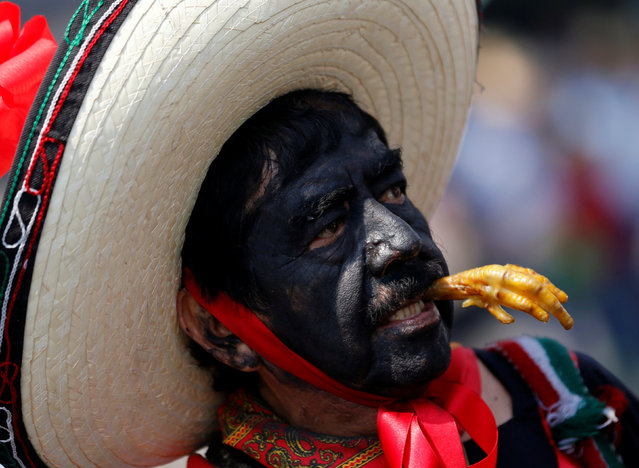 A Mexican wearing a period costume re-enacts the battle of Puebla, in the Penon de los Banos neighbourhood of Mexico City, Mexico May 5, 2016. (Photo by Henry Romero/Reuters)