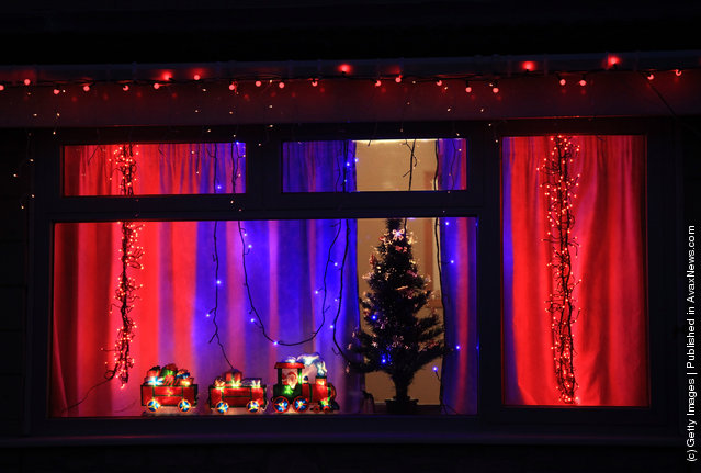 Christmas lights are seen in a house in Melksham, England
