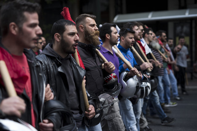 Protesters from communist-affiliated party PAME chant anti austerity slogans during a protest in central Athens, on Friday, May 6, 2016. Services have ground to a halt in Greece as workers start a three-day general strike protesting new bailout austerity measures they say will further decimate incomes, in a sign of growing discontent with the left-led coalition government. (Photo by Petros Giannakouris/AP Photo)