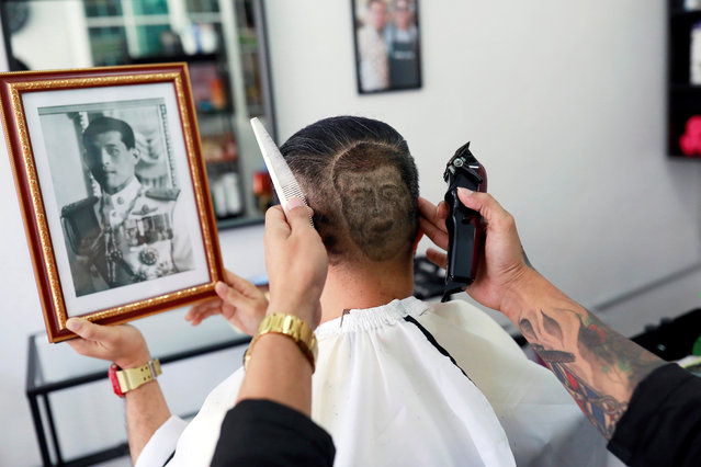 Mitree Chitinunda gets a haircut in the shape of Thai King Maha Vajiralongkorn, to mark King's 67th birthday, in a barbershop at Bangkok, Thailand on July 28, 2019. (Photo by Soe Zeya Tun/Reuters)