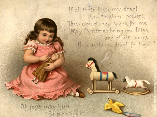 1873: A Christmas greetings card showing a child playing with her toys
