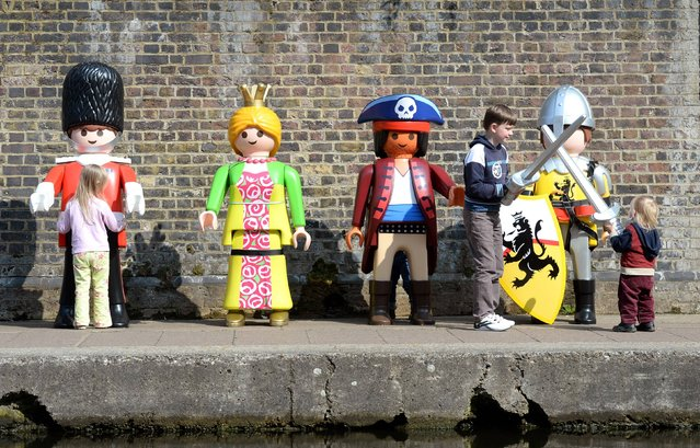 Giant Playmobil characters come to life to celebrate the launch of Playmobil's 40th anniversary, at the Pirate Castle, Camden Lock, London, on April 30, 2014. (Photo by Doug Peters/PA Wire)