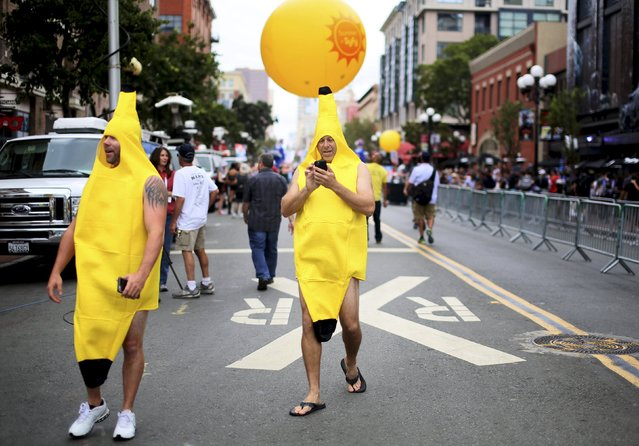 Two men dressed as a banana walk down the Gaslamp Quarter at the 2015 Comic-Con International in San Diego, California, July 9, 2015. (Photo by Sandy Huffaker/Reuters)