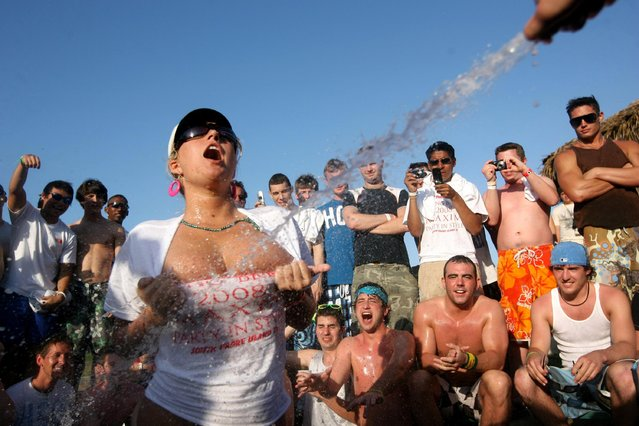 Students participate in a wet t-shirt contest at the MTV Beach Bash party put on by Global Groove at the Bahia Mar Hotel during the annual ritual of Spring Break March 26, 2008 on South Padre Island, Texas. The South Texas island is one of the top Spring Break destinations and attracts students from all over the country. (Photo by Rick Gershon/Getty Images)