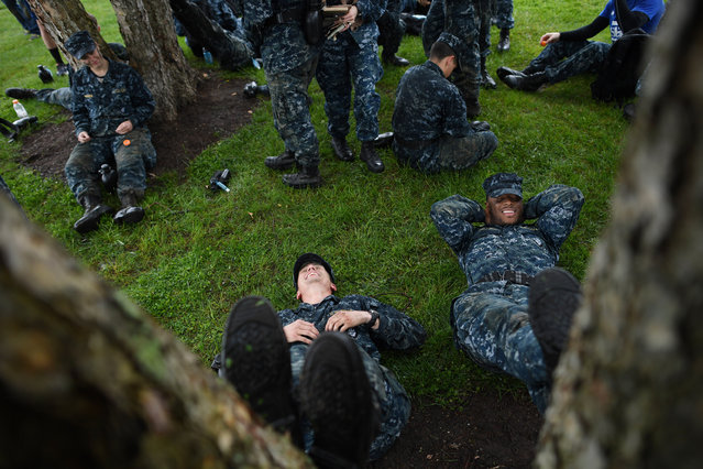 United States Naval Academy plebes, Caleb Lucero, bottom left, and Mitchell Baldwin, bottom right, take a moment to rest during Sea Trials at the United States Naval Academy on Tuesday May 17, 2016 in Annapolis, MD. (Photo by Matt McClain/The Washington Post)
