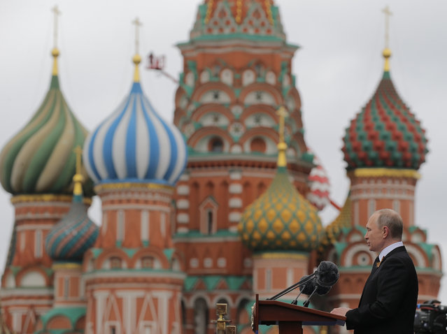 Russian President Vladimir Putin speaks at the Red Square during the Victory Day military parade to celebrate 72 years since the end of WWII and the defeat of Nazi Germany, in Moscow, Russia, on Tuesday, May 9, 2017. (Photo by Yuri Kochetkov/Pool Photo via AP Photo)