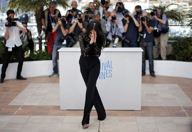 """Cast member Eva Green reacts as she poses during a photocall for the film """"The Salvation"""" out of competition at the 67th Cannes Film Festival in Cannes May 17, 2014. (Photo by Eric Gaillard/Reuters)"""
