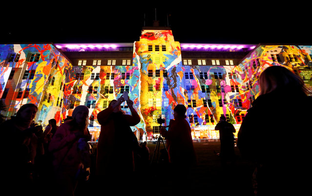 People take pictures of a design projected onto the Museum of Contemporary Art during the opening night of the annual Vivid Sydney light festival in Sydney, Australia May 27, 2016. (Photo by Jason Reed/Reuters)