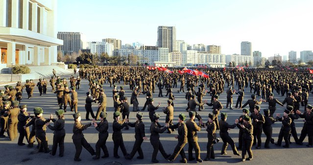 Members of North Korea's Ministry of the People's Armed Forces (MPAF) dance during a celebration of the anniversary of the February 8 founding of the regular revolutionary armed forces of Korea, at an undisclosed location in this undated photo released by North Korea's Korean Central News Agency (KCNA) in Pyongyang on February 8, 2015. (Photo by Reuters/KCNA)