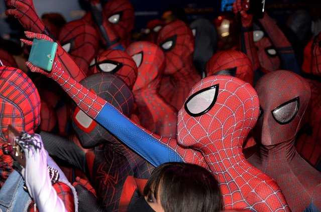 "Fans dressed in Spider-Man outfits gather at a promotional event for the forthcoming ""Spider-Man: Homecoming"" movie at the Art Science Museum in Singapore on June 7, 2017. The movie will be shown in cinemas around the world from July 5 onwards. (Photo by Toh Ting Wei/AFP Photo)"