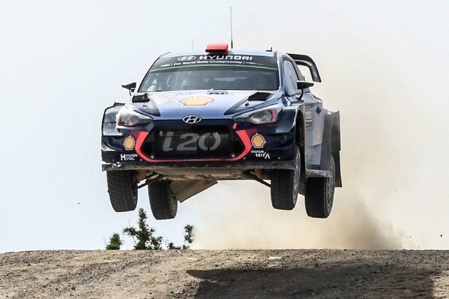 Spanish driver Dani Sordo and Spanish co-driver Marc Marti steer their Hyundai i20 Coupe WRC during the Micky's Jumps  at Monte Lerno, on the third day of the 2017 FIA World Rally Championship in Sardegna, on June 9, 2017. (Photo by Andreas Solaro/AFP Photo)