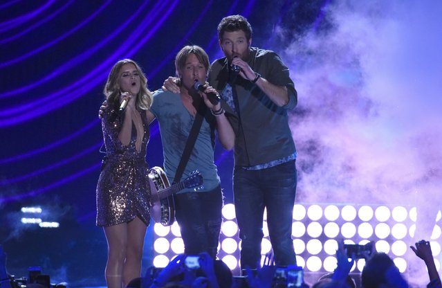 "Musician Keith Urban (C), with Brett Eldredge and Maren Morris, perform ""Wasted Time"" on stage at the 2016 CMT Music Awards in Nashville, Tennessee, U.S. June 8, 2016. (Photo by Harrison McClary/Reuters)"