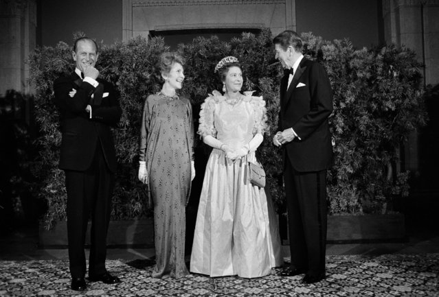 President Ronald Reagan and first lady Nancy Reagan pose for photographers with Queen Elizabeth II and Prince Philip at a formal state dinner, March 3, 1983, at the M.H. de Young Museum in San Francisco's Golden Gate Park. (Photo by Ed Reinke/AP Photo)
