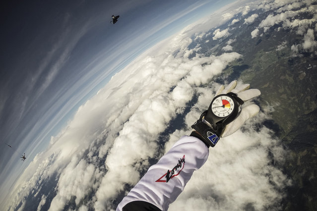 Fred Fugen seen training for a jump over Austria on May 12, 2014. Fearless skydivers jump from an altitude of 10,000 meters above the largest mountain in Europe. Frederic Fugen, 34, and Vincent Reffet, 29, leapt from a plane in the freezing skies above Mont-Blanc in the French Alps. The jump is from such a height the pictures show the curvature of the earth. (Photo by Dominique Daher/Barcroft Media)