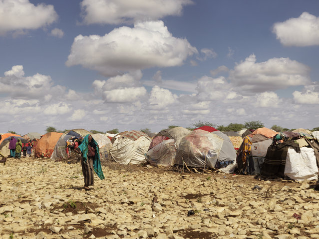 Two seasons of failed rains and insecurity have pushed 155,000 people from rural areas into Baidoa, the provincial capital of the Bay region, in the country's south west. Many have set up home at Muuri camp, gathering together in the hope food and water will reach them. (Photo by Peter Caton/Mercy Corps)