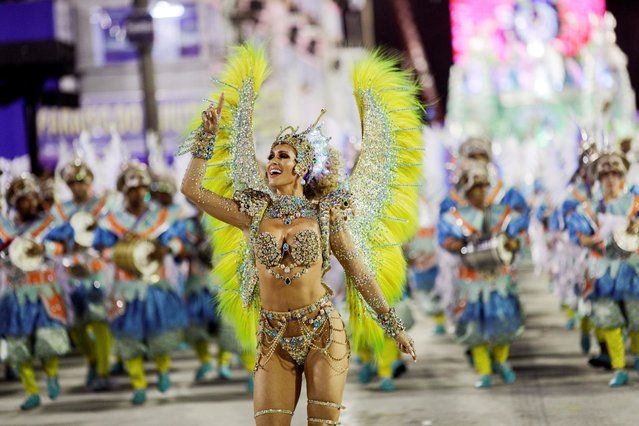 Drum queen Livia Andrade of Paraiso do Tuiuti samba school performs during the first night of the Carnival parade at the Sambadrome in Rio de Janeiro, Brazil on February 24, 2020. (Photo by Ricardo Moraes/Reuters)
