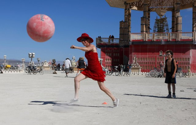 Jen Van Schmus plays kickball on the Playa as approximately 70,000 people from all over the world gathered for the annual Burning Man arts and music festival in the Black Rock Desert of Nevada, U.S. August 29, 2017. (Photo by Jim Urquhart/Reuters)