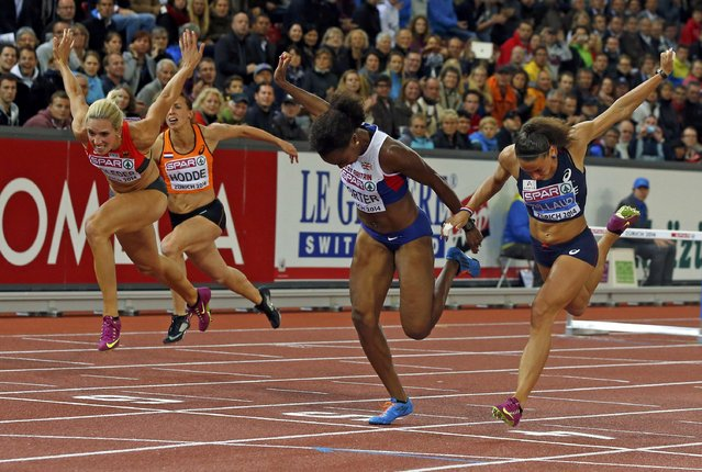Tifanny Porter of Britain (C) crosses the finish line to win in front of second placed Cindy Billaud of France (R) and third placed Cindy Roleder of Germany (L) in the women's 100 metres hurdles final during the European Athletics Championships at the Letzigrund Stadium in Zurich August 13, 2014. (Photo by Phil Noble/Reuters)