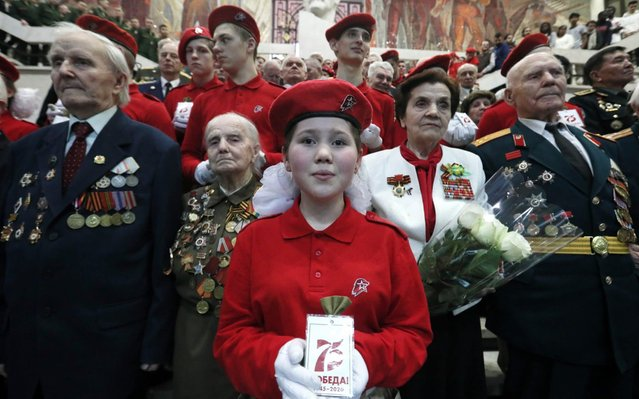 WWII veterans attend a ceremony to place tobacco pouches of soil from WWII mass graves of Red Army soldiers abroad, in the custody of the Central Armed Forces Museum in Moscow, Russia on March 6, 2020. The grave soil has been brought from Abkhazia, Germany, Kyrgyzstan, US, Ukraine, France, Estonia, Mongolia, Bulgaria, UK, Uzbekistan and South Ossetia. (Photo by Alexander Shcherbak/TASS)