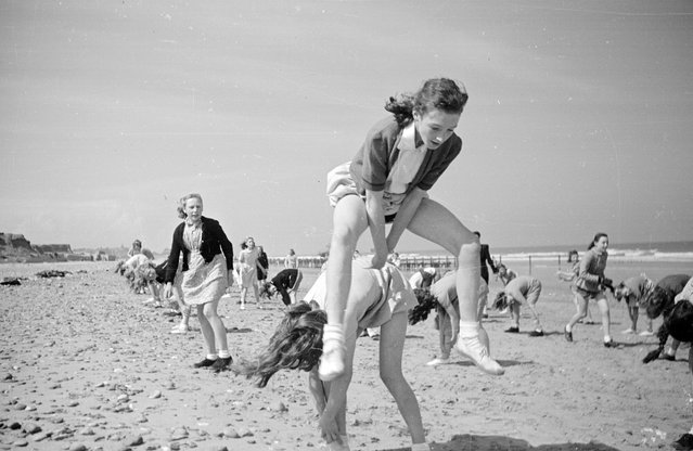 Pupils enjoying games on the beach during a working break at the residential branch of their Wakefield school by the seaside in Hornsea. 7th August 1948. (Photo by Haywood Magee)