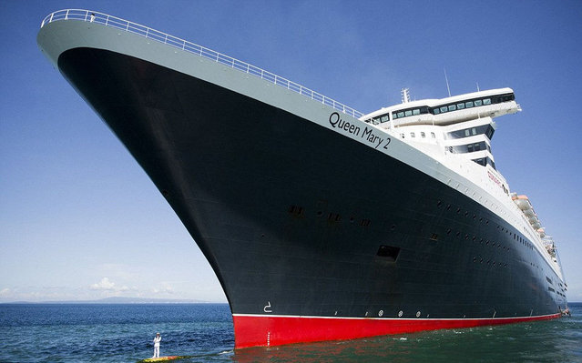 Queen Mary 2's Captain Perches On The Bow Of His Vast Ship