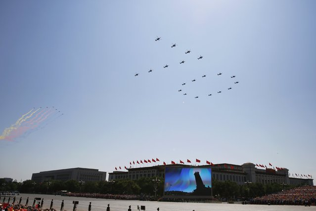 """Military helicopters form the number """"70"""" during the military parade marking the 70th anniversary of the end of World War Two, in Beijing, China, September 3, 2015. (Photo by Damir Sagolj/Reuters)"""