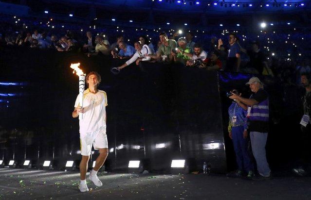 2016 Rio Olympics, Opening ceremony, Maracana, Rio de Janeiro, Brazil on August 5, 2016. Torch bearer Gustavo Kuerten arrives at the stadium. (Photo by Kai Pfaffenbach/Reuters)