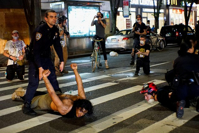 Demonstrators are detained by police officers during a protest against the death in Minneapolis police custody of George Floyd, in New York City, U.S., June 3, 2020. (Photo by Eduardo Munoz/Reuters)