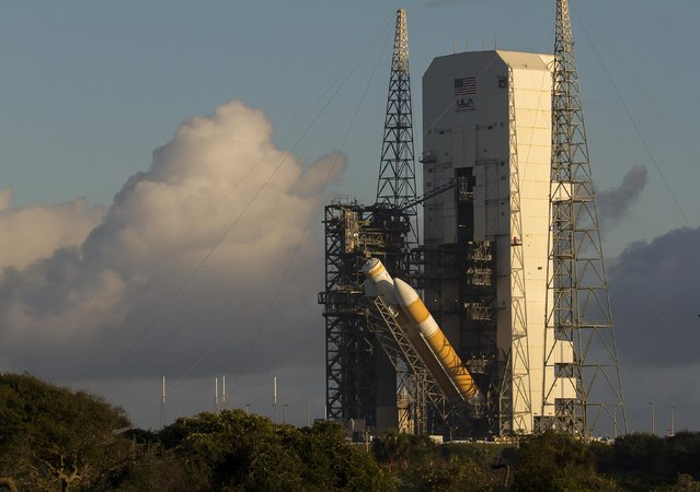 A view of the United Launch Alliance Delta IV Heavy rocket in preparation for the first flight test of NASA's new Orion spacecraft at Cape Canaveral Air Force Station, Florida October 1, 2014. The launch vehicle was moved from the Horizontal Integration Facility to the launch pad at complex 37 at Cape Canaveral Air Force Station and it is being raised to its vertical position. (Photo by Mike Brown/Reuters)