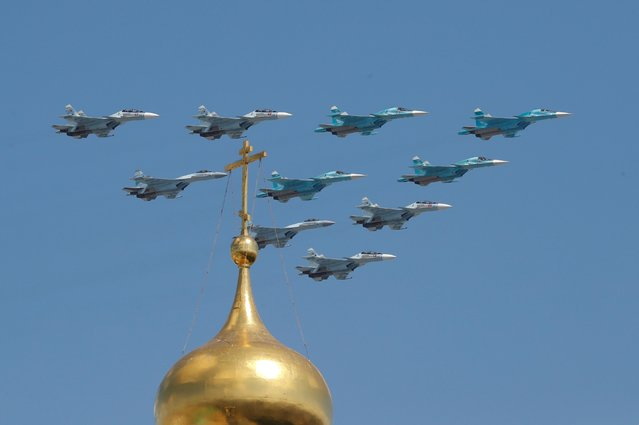 Russian Su-30SM, Su-34 and Su-35S combat aircraft fly in formation during the Victory Day Parade in Moscow, Russia on June 24, 2020. (Photo by Evgenia Novozhenina/Reuters)