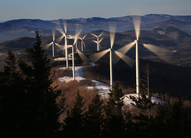 In this March 19, 2019 file photo, the blades of wind turbines catch the breeze at the Saddleback Ridge wind farm in Carthage, Maine. Scientists say emissions worldwide need to start falling sharply from next year if there is to be any hope of achieving the Paris climate accord's goal of capping global warming at 1.5 degrees Celsius (2.7 Fahrenheit). (Photo by Robert F. Bukaty/AP Photo/File)