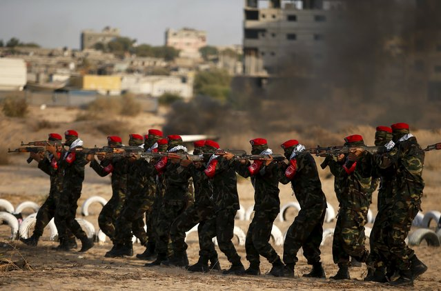 Palestinian militants from al-Husine brigade loyal to Fatah movement is seen during a military-style exercise graduation ceremony in Khan Younis in the southern Gaza Strip, September 20, 2015. (Photo by Suhaib Salem/Reuters)